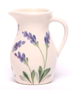 Emerson Creek Pottery Here is a small but elegant hand-painted ceramic posie pitcher. With an 8 ounce capacity, it's ideal for a single serving of iced tea or lemonade on hot summer afternoons. They a