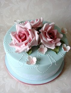 VIntage-inspired blue and lace cake. Look at those flowers! They look like porcelain! by RubyteaCakes, via Flickr
