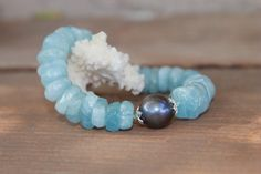 Check out this item in my Etsy shop https://www.etsy.com/listing/484307217/natural-aquamarine-gemstone-bracelet