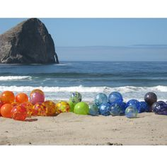 Art glass floats...every year, from Memorial Day to Labor Day, the town of Lincoln, Oregon hides these floats along the coastline for lucky people to find. Each is one-of-a-kind.