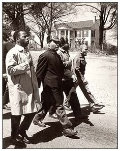 JOHN LEWIS (far left), MARTIN LUTHER KING, JR., RALPH ABERNATHY AND JAMES BEVEL, during the SELMA to MONTGOMERY MARCH, 1965.   Photo by: Spider Martin