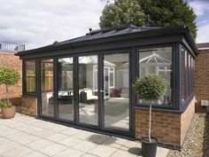 Stunning Grey Aluminium Orangery by UltraFrame with UltraFrame Skylight Roofing, and Bifolding Doors. Here at Marton Windows, we work along side our Manufacturer Ultraframe to deliver you beautiful sun-rooms and Orangeries.