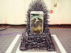 """A YouTuber just designed an Iron Throne phone charger – made with 600 tiny plastic swords - A miniature Iron Throne that doubles as a mobile phone charger takes centre stage in a step-by-step guide uploaded to YouTube by its maker.  A fan of the U.S. TV series """"Game ofThrones """", Norwegian Martina Langseth Knutsen made the charger from MDF board and tiny spray-painted plastic swords, after seeing similar Iron Throne phone holder projects online.  Knutsen, who shares her DIY guides on the…"""