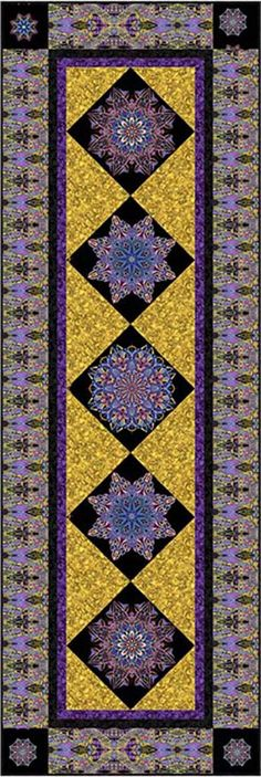 """Check out our FREE """"Stained Glass View"""" quilt pattern using the collection, """"Fabracadabra"""" by Paula Nadelstern for Benartex. Designed by Stitched Together Studios. Finished size: 28-1/2"""" x 85""""."""