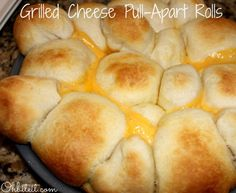Grilled Cheese Pull-Apart Rolls | Not sure what came over me, but one minute I was cleaning out the fridge and the next minute I was stuffing obscene amounts of Cheese into Biscuit Dough, rolling it into balls, drenching it Butter and baking them until this happened..lol! | From: ohbiteit.com