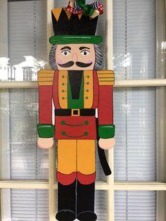 Items similar to nutcracker door hanger, Christmas decorations, wood door hangers on Etsy Christmas Yard Art, Christmas Wood Crafts, Christmas Signs, Christmas Projects, Diy Christmas, Nutcracker Christmas Decorations, Outdoor Christmas Decorations, Christmas Ornaments, Nutcracker Crafts