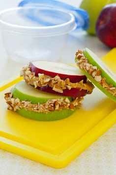 Good workout snack. Mix up granola and peanut butter and spread between two thick apple slices for a hearty, fruity sandwich!!