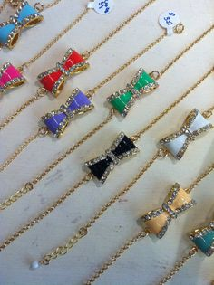 Items similar to Enamel and Rhinestone Bow Bracelet on Etsy Bow Bracelet, Rhinestone Bow, Summer Bracelets, Arrow Necklace, Enamel, Bows, Trending Outfits, Unique Jewelry, Handmade Gifts