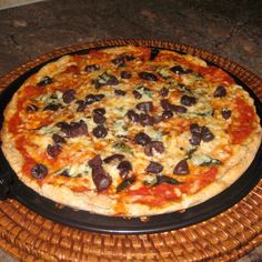 Blasphemous Margherita Pizza --Whole wheat pizza with cheese, basil, black olives, and homemade sauce.