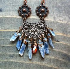 Long boho necklace: Raw kyanite points are perfectly framed in a gorgeous antique copper amulet. By BlueTribe