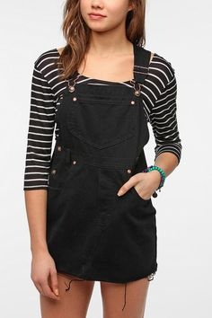 Urban Outfitters Renewal Cutoff Overall Dress \\ If you like to thrift shop, find yourself a decent pair of overalls and cut the pant legs off for a cute dress. Skip the hem if you like the frayed look. Pair it with a bright colored  belt for a feminine modern touch.