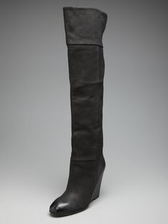 Tall black wedge boot I have a pair of these, very comfy.