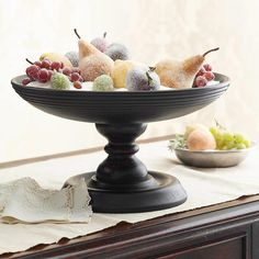 DIY> Sugar-Coated Fruit Centerpiece  There's nothing sweeter than this sugary holiday centerpiece. Fill an ebony wood compote with artificial snow. Embellish with wax sugar-coated pears, plums, and grapes.