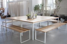 http://www.remodelista.com/posts/office-visit-the-everlane-studio-in-san-francisco - white powdercoated steels legs with wooden tops from Ohio Design: http://www.remodelista.com/posts/honest-furniture-from-ohio-design-in-san-francisco