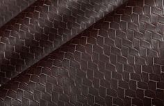 Braid Discount Vinyl Upholstery in Truffle Brown has a real leather look with added texture. This durable fabric works in either classic or contemporary designs. The designer fabric is discounted to only $20 per yard, a real deal. Order your free sample swatch before this interior design fabric sells out!