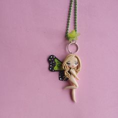 Sign of the butterfly necklace pound in fimo polymer par Artmary2