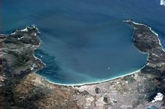 Southern Suburbs of Cape Town, South Africa, with Table Mountain framing the bay.