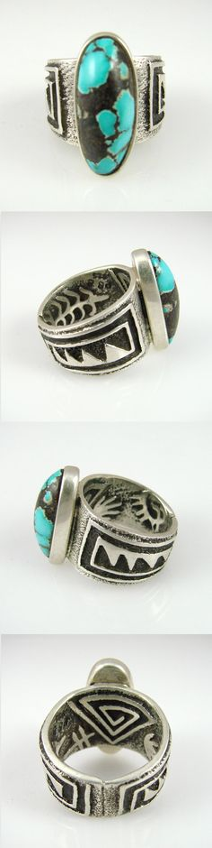 Kingman Turquoise Ring  by Philander Begay (Navajo). Sterling Silver Ring with a Tufa Cast Band with both Interior and Exterior Designs and Set with a Kingman Turquoise Stone. [The details on this ring from the different angles are so cool!]