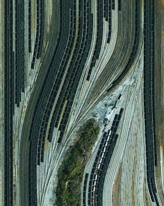 Train cars filled with coal are stationed in Norfolk, Virginia. Operated by the Norfolk Southern corporation, Lamberts Point Pier 6 is the largest coal-loading station in the Northern Hemisphere and serves at the temporary depot for the company's fleet of Train Car, Train Tracks, Norfolk Southern, Norfolk Virginia, Aerial Photography, Art Photography, Night Photography, Sculpture Textile, Aerial Images