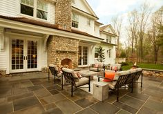 Beautiful Stone Fireplace added to the outside wall with a large patio area