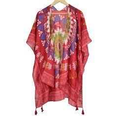 This eye catching sheer shawl features a vibrant tribal print in shades of red, beige and navy. Perfect for layering this season, you won't have a hard time matching this shawl up with an outfit. It has armholes to ensure that this shawl stays put and won't shift around on you. Bottom corners have multiple tassels hanging down from each. We recommend you wash in delicate in cold water and hang to dry.