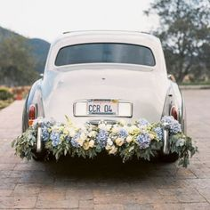Florals are a great way to customize your vintage car. #vintagecar #wedding #weddingstyle #seizetheday #brideandgroom #weddingcar