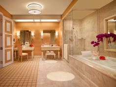 The Wynn Parlor Suite bathroom decor echoes that of the Wynn Spa. The massive bathroom is decked out with His and Hers basins, a whirlpool d...