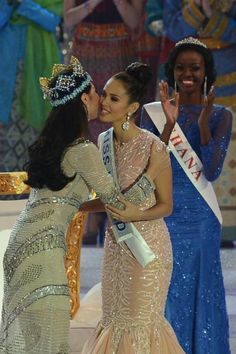 New Miss World, Megan Young (C), from the Philippines is congratulated by outgoing Miss World Yu Wenxia (L) after winning the crown during the Miss World 2013 finals in Nusa Dua, in Indonesia's resort Miss World 2013, Miss Universe 2013, Megan Young, Miss Philippines, Miss Monde, Miss France, Beauty Pageant, Beauty Queens, Most Beautiful Women
