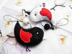 Hey, I found this really awesome Etsy listing at http://www.etsy.com/listing/91174129/pair-of-felt-bird-black-and-white-in