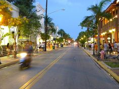 Duval Street at Dusk. Key West, Florida. Love it! Some of my best childhood memories are here.