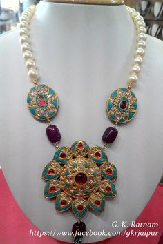 Turquoise kundan-meena pendant set.