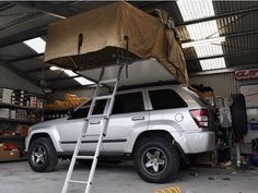 Built Jeep Grand Cherokee WK with roof top tent by Murchison Products Australia