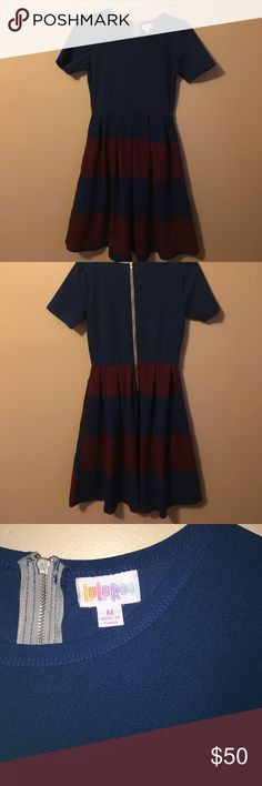 LulaRoe Amelia dress LulaRoe Amelia dress. Medium. Made in China. Cerulean blue and maroon block stripes. 97% polyester 3% spandex. LuLaRoe Dresses Midi