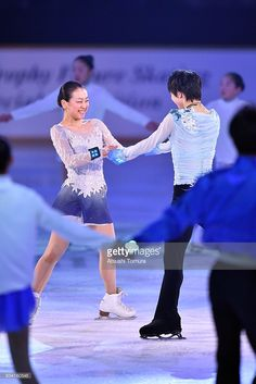 Mao Asada (L) and Yuzuru Hanyu (R) of Japan perform thier routine during the NHK Special Figure Skating Exhibition at the Morioka Ice Arena on January 9, 2016 in Morioka, Japan.