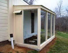 How to build a greenhouse of used sliding-glass patio doors that is warmer and less expensive than plastic, and keeps out burrowing animals.data-pin-do=