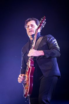 Charlie Burchill of Simple Minds performs live at Mediolanum Forum in Assago
