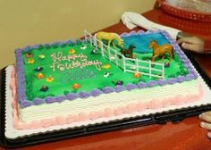 cake idea -- field with flowers (to keep it girly) and the horses off to one side