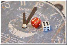 Rolling Around the Clock Game: Each player gets a clock.  Must roll number of next hour chronologically to move hands.