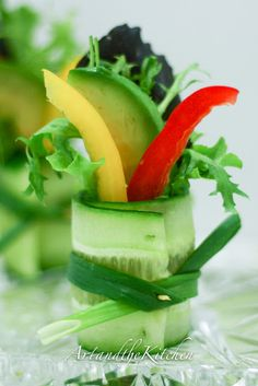 Cucumber Salad Bites- a decorative way to eat your salad or garnish a plate. Drizzle your favorite dressing on top or a side dish for dipping.