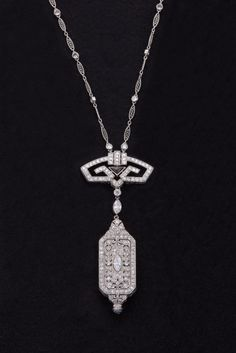 Art Deco Onyx, Diamond & Platinum Pendant Watch & Chain. Beautiful pendant watch & chain, done in intricately pierced geometric designs & bead & bezel-set with 225 single-cut, old European-cut, Transitional-cut, marquise-shaped, rose-cut & round brilliant-cut diamonds...Clasp is 14kt white gold, signed Cartier & added at a later date.