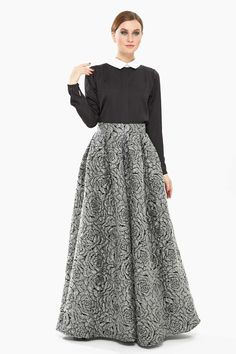 Elegant Xela - Black, White and Shades of Grey Set, includes: adorable top designed with spread neckline, long sleeves, contrast trims, and amazing maxi skirt with high waist band, floral design, pleats details, For a sophisticated evening look, team with a pair of high heels and simple clutch.