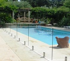 Removable pool fence with lock in deck posts protect a for Plexiglass pool fence