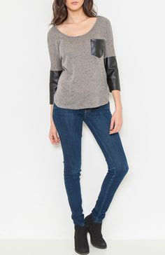Round neck 3/4 sleeve knit top featuring pleather sleeves, pleather breast pocket, and asymmetrical hem. Rock that pleather in your everyday outfit. #Wholesale Tops #clothing wholesale, #Casual #Day Tops, #Boutique #Wholesale Boutique, #Mod #Vintage, #New Wholesale Trends, #FallTrends