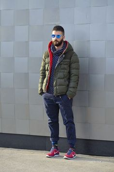 Polka Dot Hoodie styled with Olive Puffer Jacket, Navy Jeans and a pair of Red…