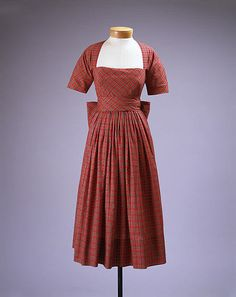 Dress Claire McCardell  (American, 1905–1958) Manufacturer: Townley Frocks (American) Date: 1949–50 Culture: American Medium: cotton, brass Dimensions: Length (skirt only): 32 1/2 in. (82.6 cm) Credit Line: Gift of Irving Drought Harris, in memory of Claire McCardell Harris, 1958 Accession Number: C.I.58.49.19