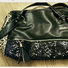 Beautiful Boutique  hand bag Black sequined and cheetah hand bag. Very cool bag. Has shoulder strap and handles. New with lots of bling! Glam Bag Bags Satchels