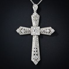 This big, bold and brilliant vintage platinum and diamond cross is bursting with carats of bright white transitional European-cut, baguette and single-cut diamonds. The high-quality central diamond, which weighs carats, radiates from within Cross Jewelry, Art Deco Jewelry, Fine Jewelry, Jewellery, Cross Necklaces, Belle Epoque, Wedding Band Tattoo, Wedding Bands, Wedding Dress