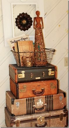 Another great way to display collectibles such as  vintage suitcases. Getting organized , doesn't mean you have to give up what you love! Keep it and stylishly arrange it!! That's my motto!