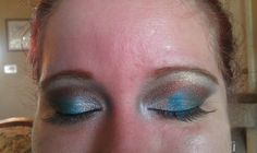 Ice in inner corner, Lapis in middle of eyelids, Peacock on end of eyelids, Bronze Star in crease and Smooth for a highlighter all by Surreal Makeup :)