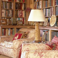 """Antique, lime-washed oak [link url=""""http://www.houseandgarden.co.uk/interiors/bookshelf-ideas-living-room-study-design""""]bookcases[/link] line the walls of this [link url=""""http://www.houseandgarden.co.uk/interiors/living-room""""]living room[/link], which also features objets and curiosities filling spare shelf space. This is a [link url=""""http://www.houseandgarden.co.uk/interiors/real-homes/new-house-in-the-scottish-borders""""]new build house in the Scottish Borders[/link] belonging to artist Sue…"""